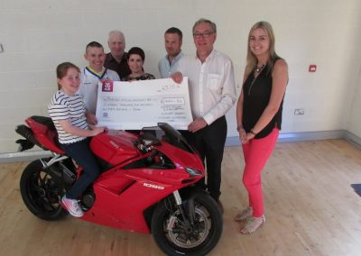 Benny Mullan who ran the Boston Marathon, and his brother in law from Inishowen Motorcycle club donate over €16,000 to the Friends.